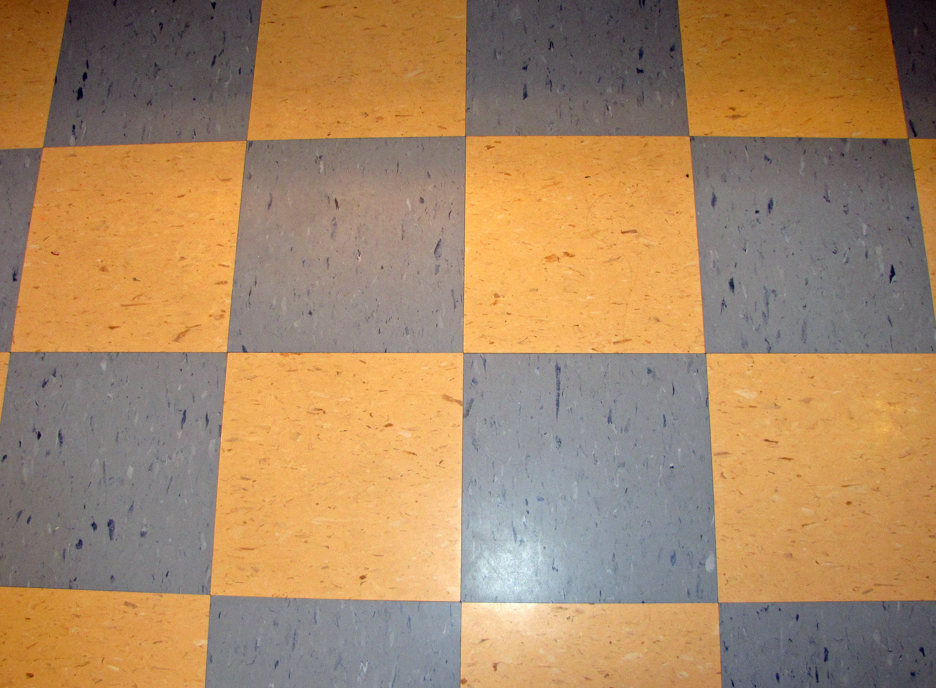 Vinyl tile destashio for Vinyl tile over linoleum